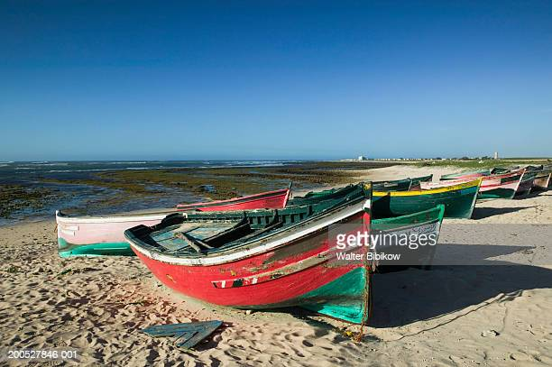 Colourful fishing boats on sandy beach