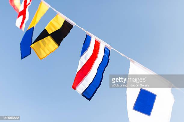 colourful flags at the old gaffers festival - s0ulsurfing stock pictures, royalty-free photos & images