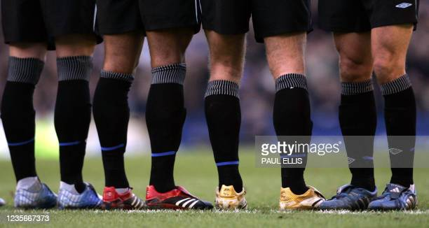 Colourful football boots of the Chelsea defensive wall line up against an Everton free kick during their English FA Cup match at Goodison Park,...