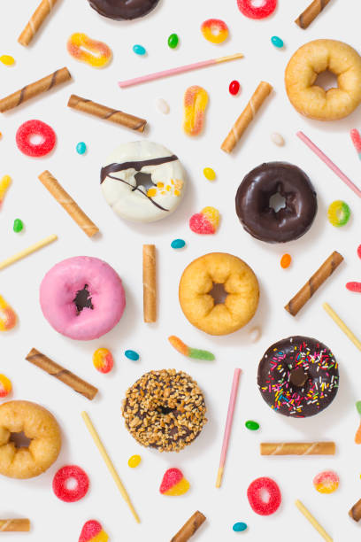 colourful glazed donuts, candy and snacks on white background. - 甜品 個照片及圖片檔