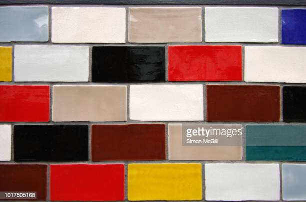 colourful glazed rectangular ceramic tiles on the exterior wall of a building - wall building feature stock pictures, royalty-free photos & images