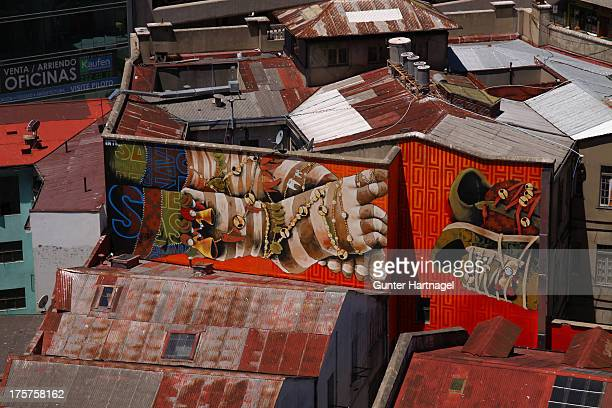 Colourful graffiti over the roofs of Valparaíso.