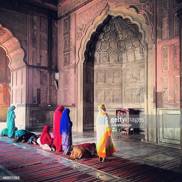 colourful group of women paraying in the mosque - mosque stock pictures, royalty-free photos & images