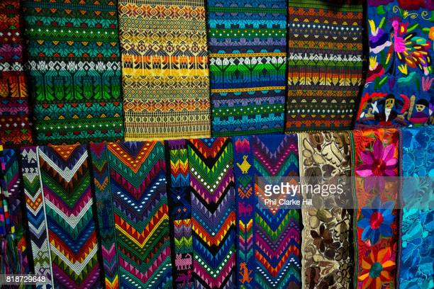 Colourful Guatemalan textiles in Panajachel the largest settlement on the banks of Lake Atitlan Lake Atitlan is seen as the most important single...