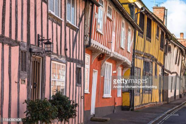 colourful half timbered houses on water street part of the historic wool village of lavenham, suffolk, england, united kingdom, europe - lavenham - fotografias e filmes do acervo