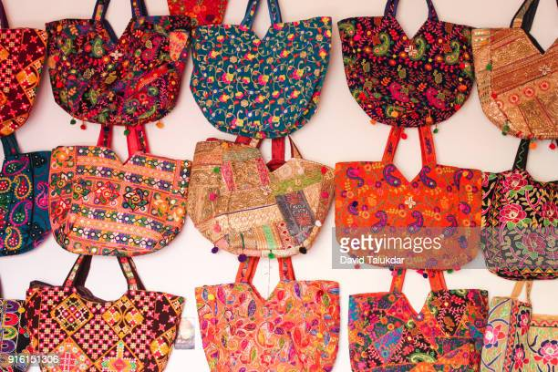 colourful handmade ladies bags - multi coloured purse stock photos and pictures