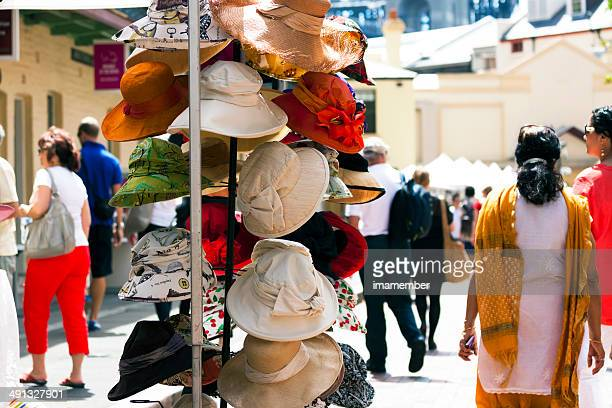 Colourful hats stall with crowd enjoying in sunny day