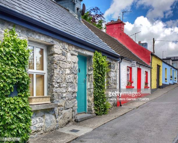 colourful houses against sky - ireland stock pictures, royalty-free photos & images