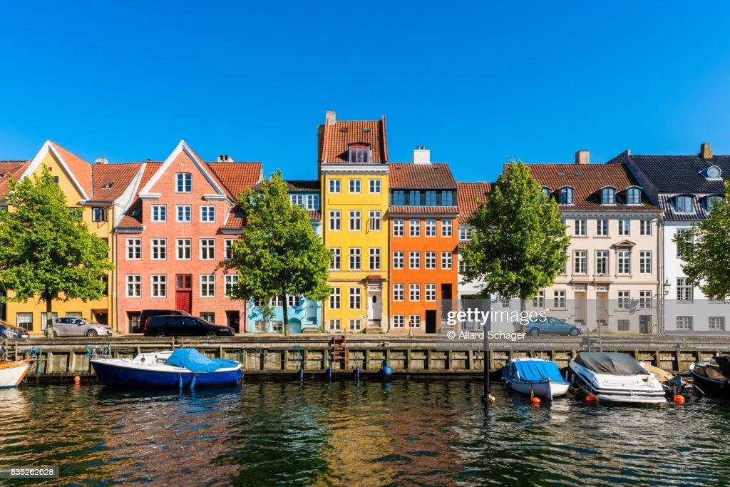Colourful houses along canal in Copenhagen Denmark : Stock Photo