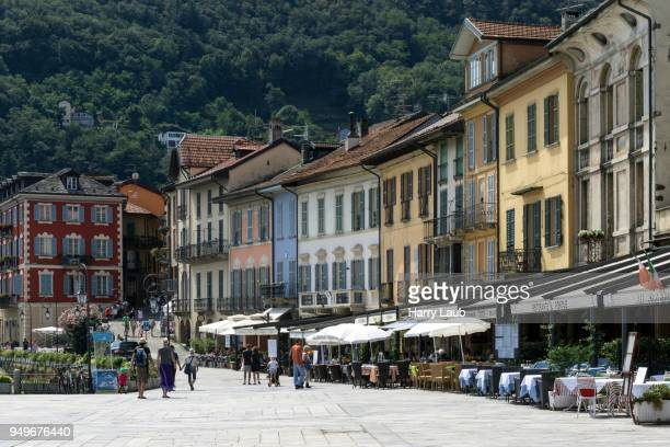Colourful houses and restaurants on the promenade, Old Town of Cannobio, Lago Maggiore, Verbano-Cusio-Ossola Province, Piedmont Region, Italy