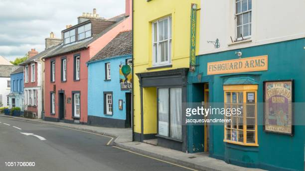 colourful houses in fishguard, wales (united kingdom) - inn stock pictures, royalty-free photos & images