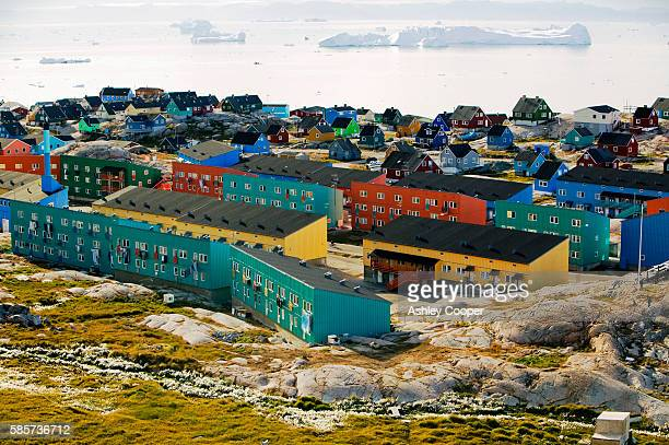 colourful houses in illulisat on greenland. ilulissat is a unesco world heritage site because of the jacobshavn glacier or sermeq kujalleq which is the largest glacier outside antarctica. the glacier drains 7% of the greenland ice sheet and produces enoug - houses in antarctica stock pictures, royalty-free photos & images