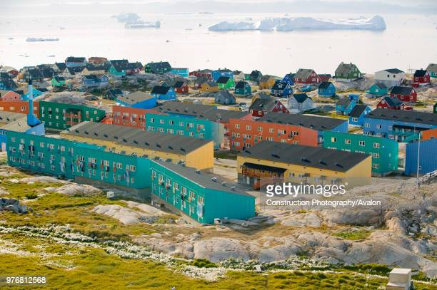 Colourful houses in Illulisat on Greenland Ilulissat is a UNESCO World Heritage Site because of the Jacobshavn Glacier or Sermeq Kujalleq which is...