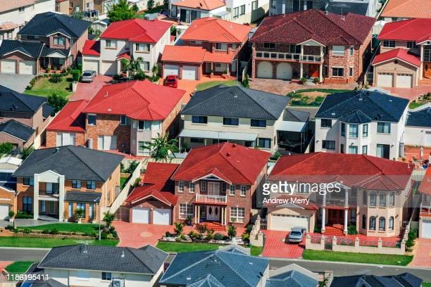 colourful houses in suburb, suburban streets, urban sprawl, city life in sydney, australia, aerial photography - ziegelbau stock-fotos und bilder
