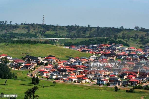 colourful houses on hill, suburb at edge of city, urban sprawl, sydney, australia, aerial photography - urban sprawl stock pictures, royalty-free photos & images