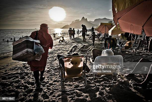 Colourful Ipanema beach landscape with man selling