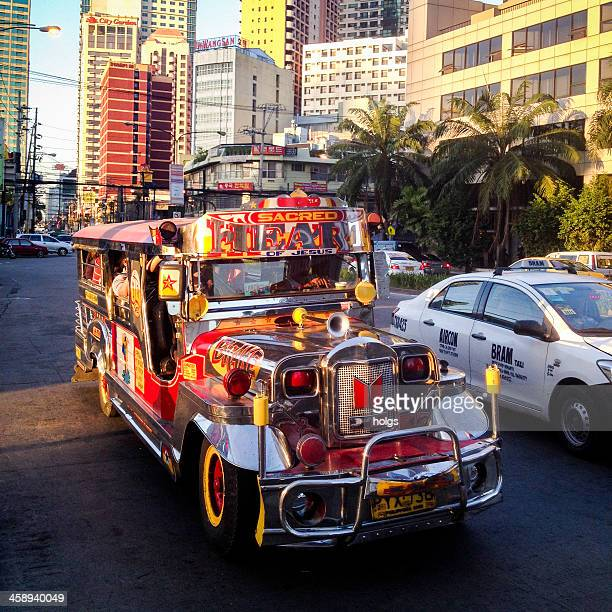 colourful jeepney vehicle in makati city, philippines - makati stock photos and pictures