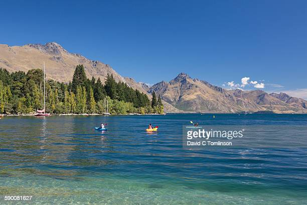 colourful kayaks on lake wakatipu, queenstown - otago region stock pictures, royalty-free photos & images