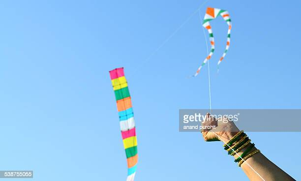 colourful kites flying in clear blue sky, india - makar sankranti stock pictures, royalty-free photos & images