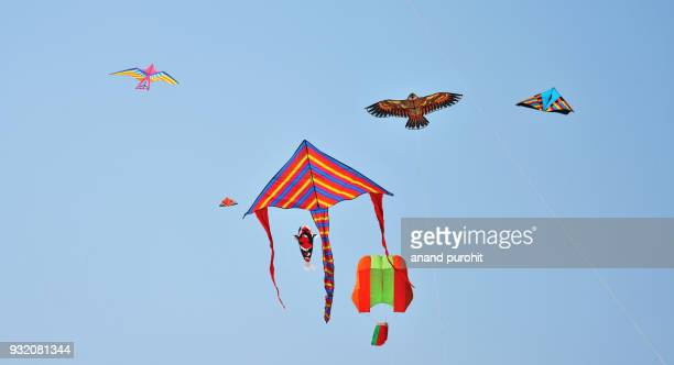 colourful kites in clear blue sky, ahmedabad, gujarat, india 2018 - makar sankranti stock pictures, royalty-free photos & images