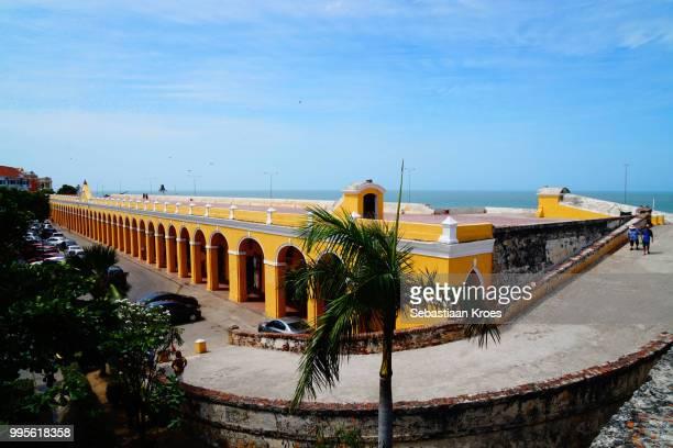 Colourful Las Bovedas Building with people, Cartagena, Colombia