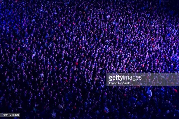 colourful light on large crowd of people - abundance stock pictures, royalty-free photos & images