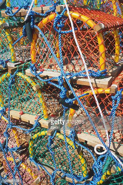 Colourful lobster pots in Crail harbour, East Neuk of Fife, Scotland, June 1997.