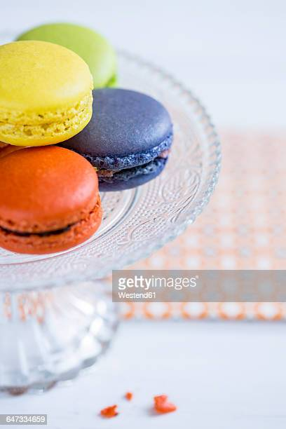 Colourful macarons on a cake stand
