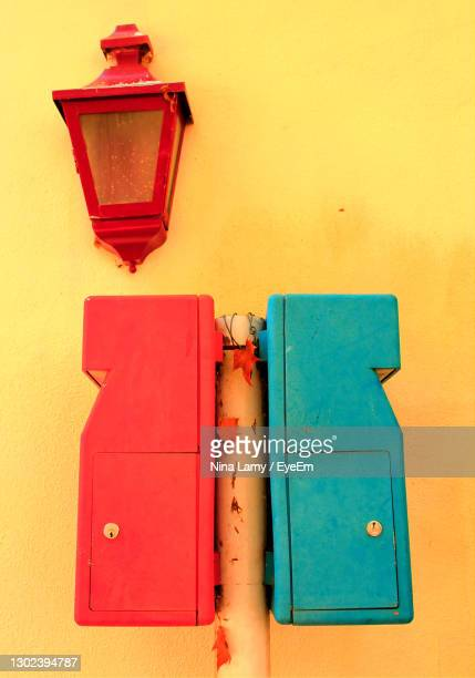 colourful mail boxes on yellow wall in portugal - モンシケ ストックフォトと画像