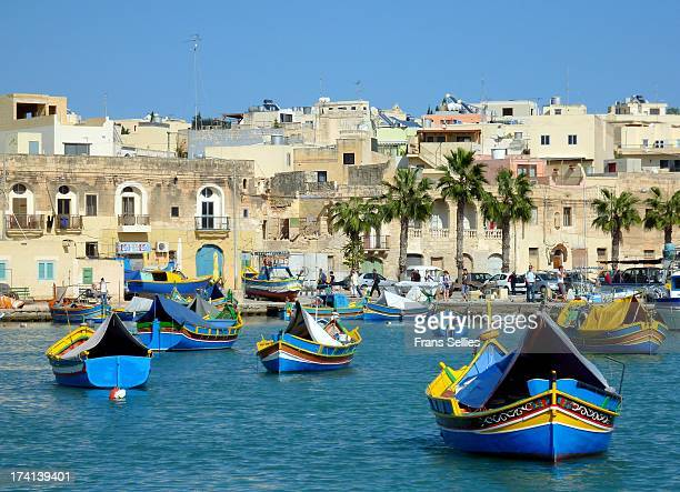 CONTENT] Colourful Maltese luzzu's or fishing boats in the harbour of Marsaxlokk in Malta