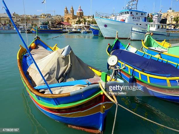Colourful Maltese luzzu's or fishing boats. These fishing vessels are usually painted in gaudy colours and they are a feast of colour worth watching....