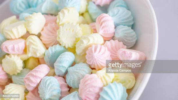 Colourful meringue dots in a white bowl