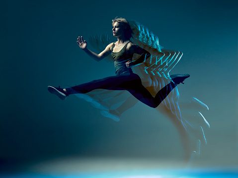 Colourful mid air shot of girl jumping - gettyimageskorea