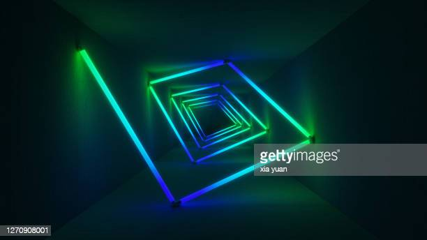 colourful neon lights illuminating tunnel - fluorescent light stock pictures, royalty-free photos & images