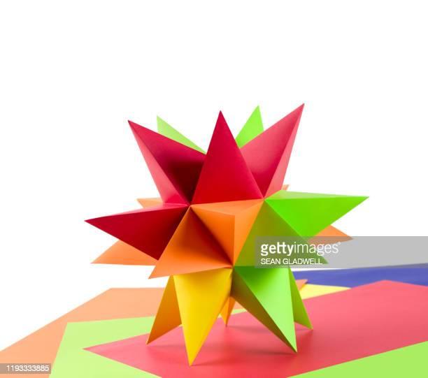 colourful origami star on paper - 尖っている ストックフォトと画像