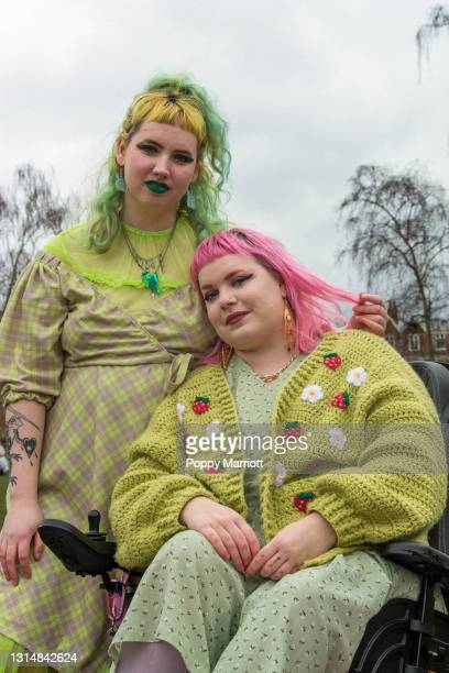 colourful outdoor portrait of a young non-binary couple - human relationship stock pictures, royalty-free photos & images