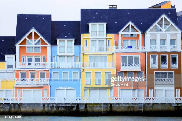 Colourful painted houses on Deauville beach