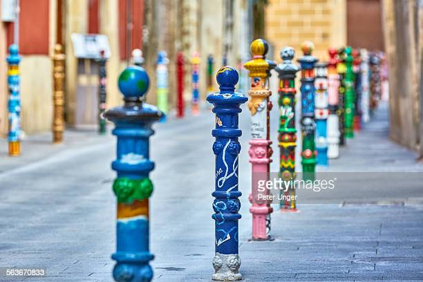 Colourful parking bollards in street, Tarragona