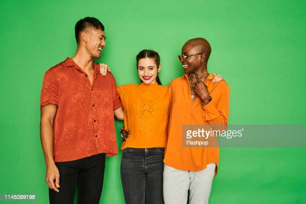 colourful portrait of a small group of friends having fun together - casual clothing stock pictures, royalty-free photos & images