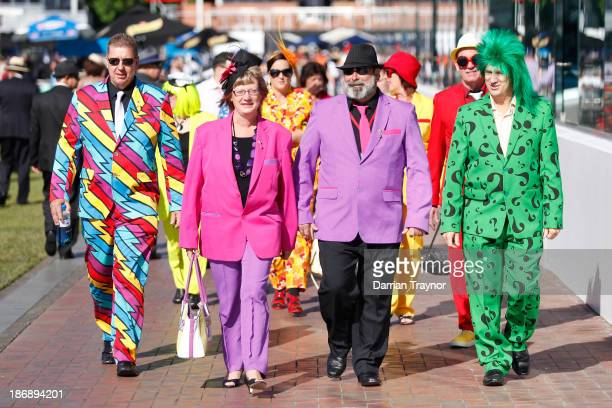 Colourful racegoers arrive for Melbourne Cup Day at Flemington Racecourse on November 5 2013 in Melbourne Australia
