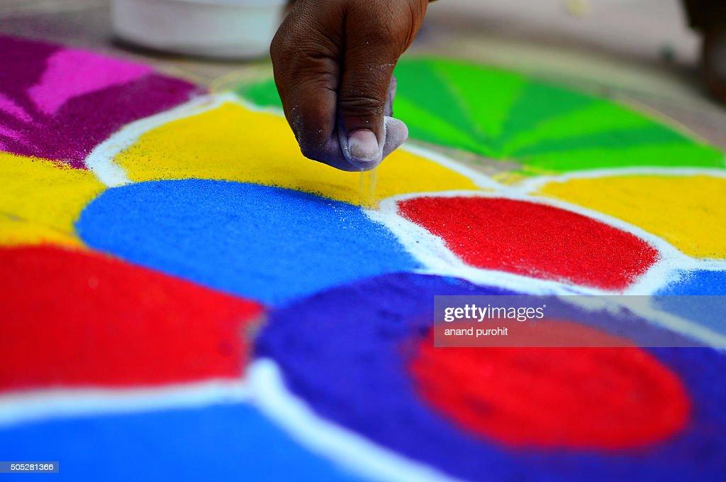 Colourful rangoli making, Diwali festival, India : Stock Photo