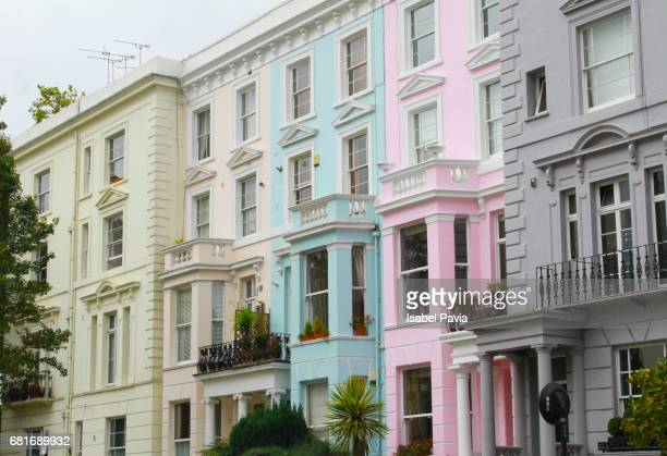 Colourful residential buildings in a row, Notting Hill; London, England