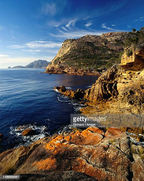 Colourful rock formations and sweeping cliffs along the spectacular coastline at Sleepy Bay.