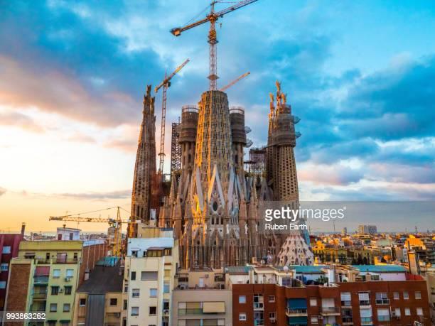 colourful sagrada familia church during sunrise in barcelona - sagrada familia stock pictures, royalty-free photos & images