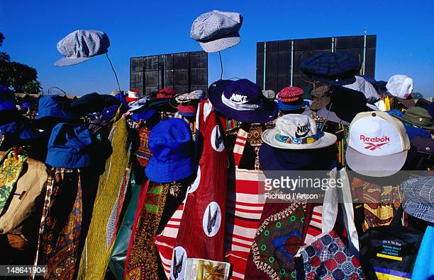 Colourful scarves and hats for sale at a stall at the Mbare Market