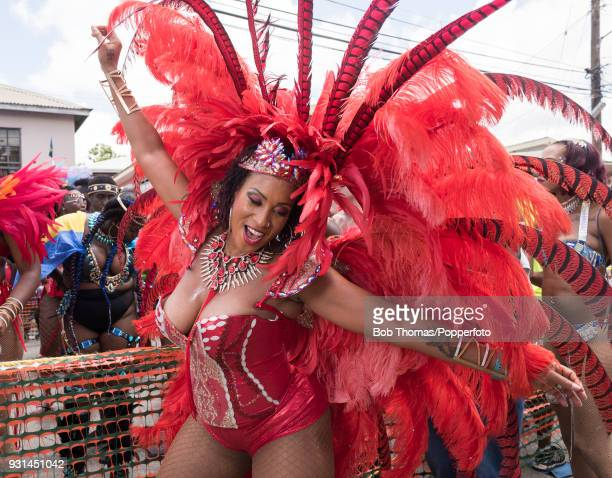 Colourful scenes with people dancing in the streets during the Crop Over Grand Kadooment Carnival in Bridgetown Barbados 7th August 2017 Grand...