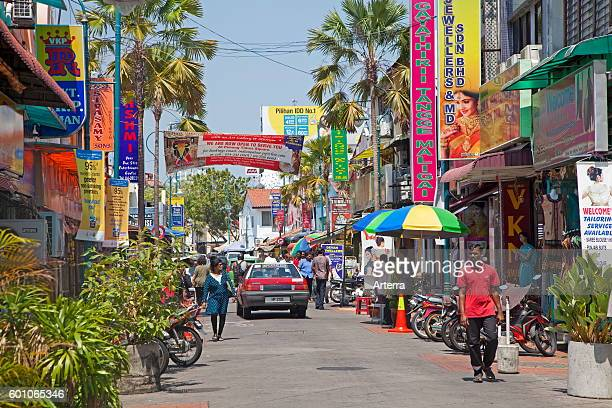 Colourful signboards in shopping street in Little India ethnic Indian enclave in the city George Town / Georgetown Penang Malaysia
