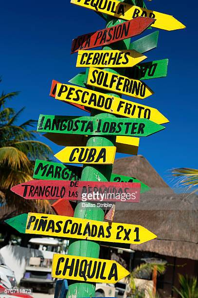 Colourful sign-post on the beach, on Holbox Is.