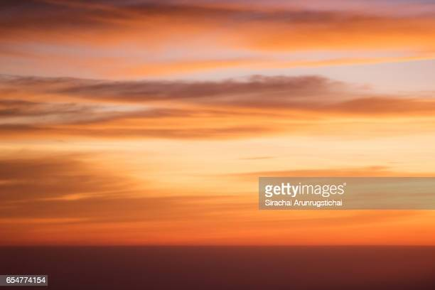 Colourful sky over clouds at sunrise