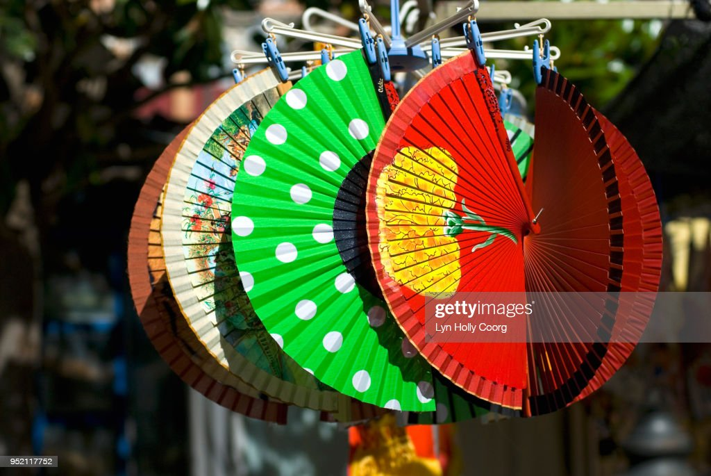Colourful Spanish fans for sale in marketplace : Stock Photo